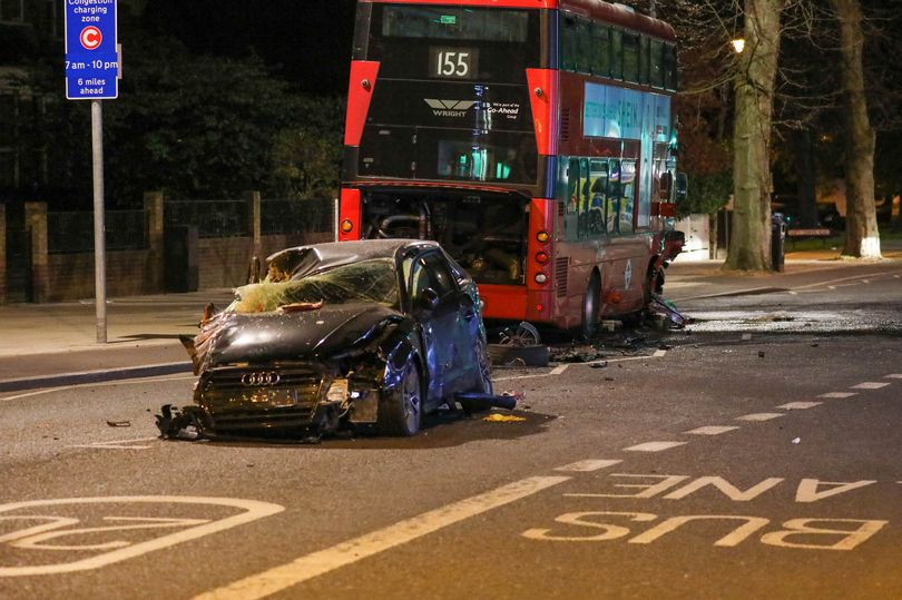 Driver freed from smashed car after ploughing into bus following police chase